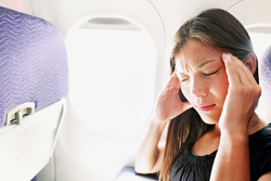 A Woman on a Plane Suffering Dizziness or Motion Sickness